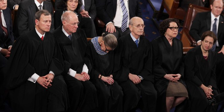 Ruth Bader Ginsburg Leans on U.S. Marshal